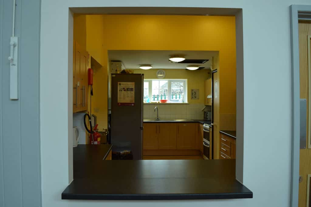 Photo of view into kitchen from church hall serving hatch